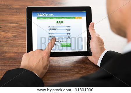 Businessman Filling Tax Return Form