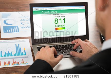 Businessman Checking Credit Score