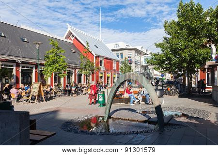 Square In Reykjavik With A Fountain And Outdoor Cafes