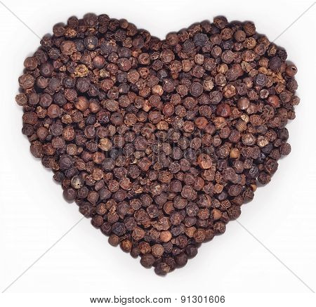 Black Pepper In The Form Of Heart On A White