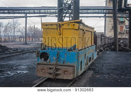 Train In National Colors With Trolleys In A Coal Mine. Donbass, Ukraine