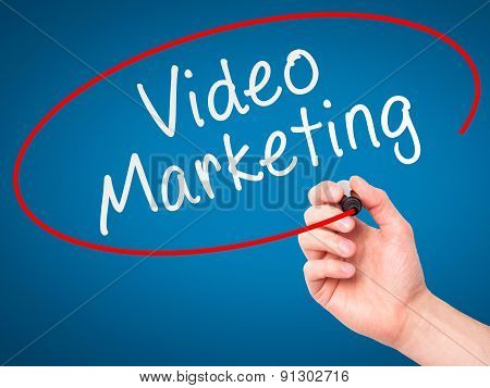 Man Hand writing Video Marketing black marker on visual screen