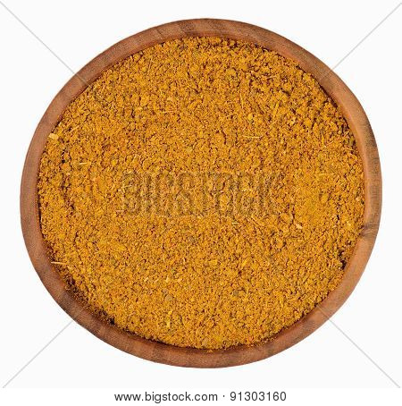 Curry Powder  In A Wooden Bowl On A White