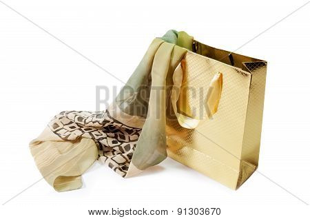 Gold Gift Bag And  Green Silk Scarf Isolated On White