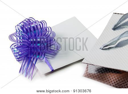 Note Card With Violet Bow And Silver Gift Bag Isolated On White