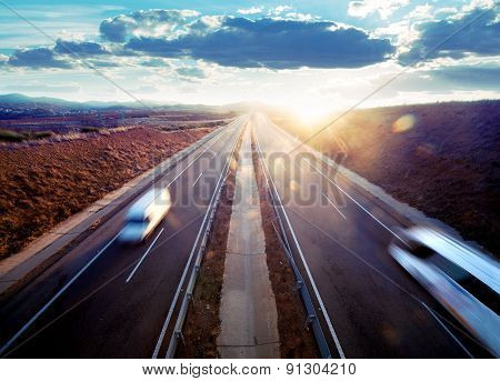 Road transport and sunset