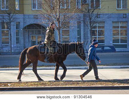 Makeevka, Ukraine - February, 22, 2015: Boy Ride A Loshadisoldata Donetsk People's Republic During T
