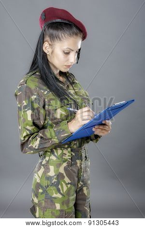 Military Female Writing In Notebook  Isolated On Gray Background
