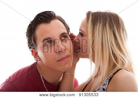 Girl Is Whispering In Ear Of Boyfriend