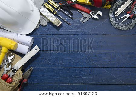 Construction Tools on Blue Wood.