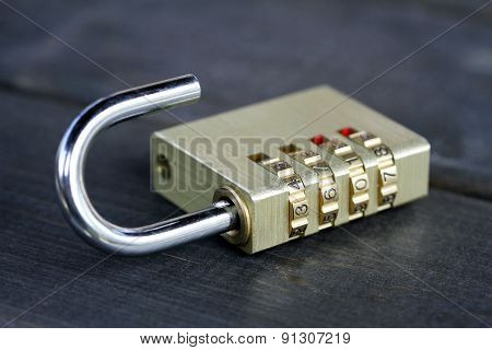 Combination Padlock On Wooden Table