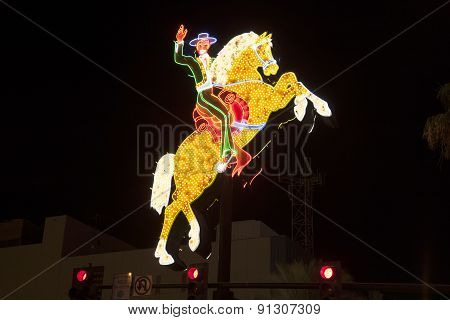 Rider On Neon Sign In Fremont Street In Las Vegas, Nevada By Night