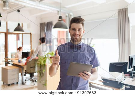 business, startup and people concept - happy businessman or creative male office worker with tablet pc computer