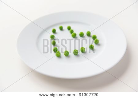 healthy eating, dieting, vegetarian food and cooking concept - close up of plate with peas in shape of heart