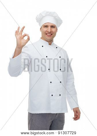 cooking, profession, gesture and people concept - happy male chef cook showing ok sign