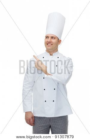 cooking, profession, advertisement and people concept - happy male chef cook pointing finger up to something