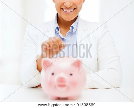 banking and finances concept - picture of lovely woman with piggy bank and cash money
