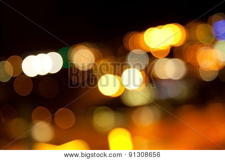 holidays, illumination and electricity concept - golden bright lights on dark night background