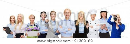 people, profession, qualification, employment and success concept - happy businesswoman over group of professional workers
