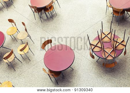 Round Tables And Chairs Stand In Empty Interior