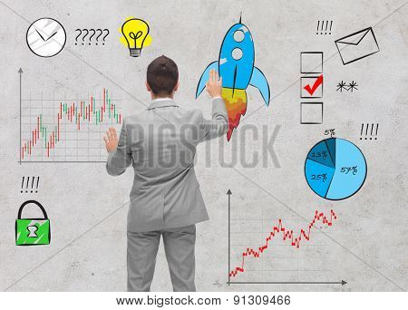 business, people, startup and management concept - businessman touching doodles from back