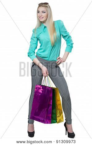 Shopping beautiful happy girl with colored bags