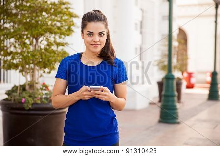 Cute Girl Texting On A Phone