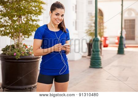 Pretty Latin Runner With Earbuds