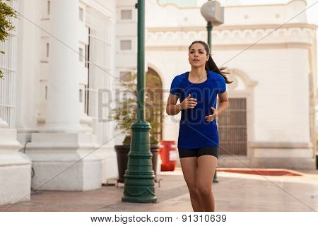 Cute Girl Jogging In The City