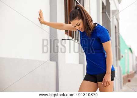 Tired Runner Leaning On A Wall