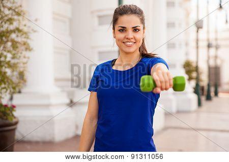 Happy Girl Lifting Dumbbells