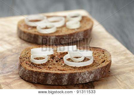 rye bread grated with garlic with leek, crostini