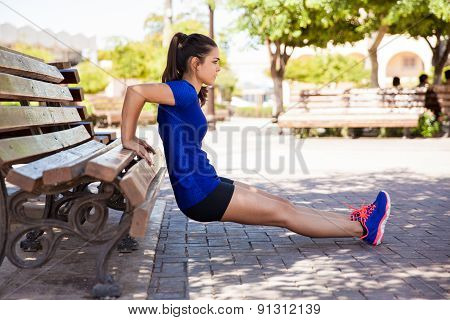 Working Out On A Park Bench