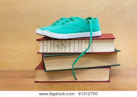 A Pair Of Shoes On A Stack Of Books
