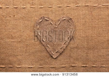 Heart Made Of Burlap  Lies On A Sacking  Background