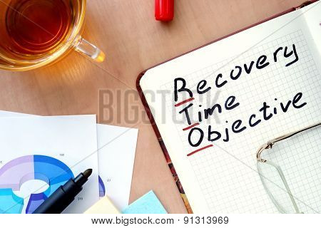 Notepad with word RTO recovery time objective concept.
