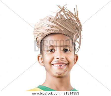 Boy wearing caipira clothes for the Brazilian Junina Party (Festa Junina) on white background