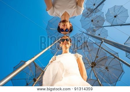Portrait of Couple on the abstract background with umbrellas