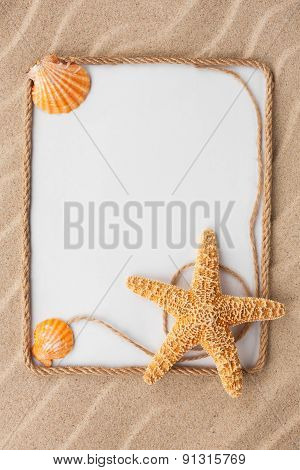 Beautiful Frame Of Rope And Star And Sea Shells With A White Background On The Sand