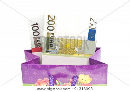 Colorful Gift Bag With Banknotes Closeup