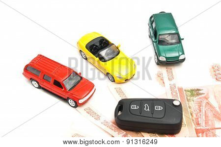 Three Cars, Keys And Russian Banknotes