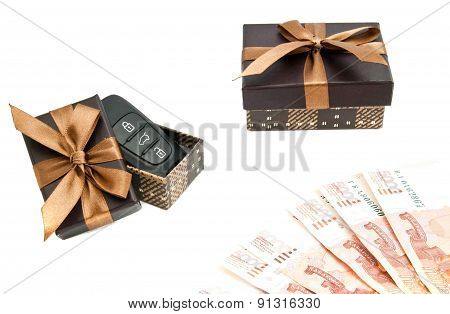 Keys, Banknotes And Brown Gift Boxes