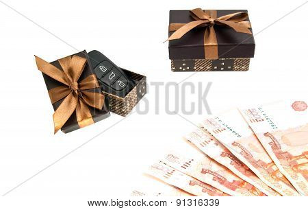 Car Keys, Banknotes And Brown Gift Boxes