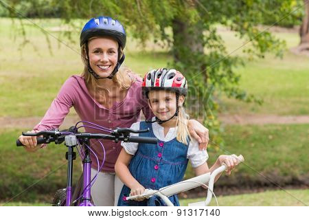 Mother and her daughter on their bike on a sunny day