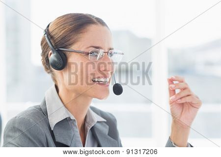 Businesswoman with headset in call centre in office