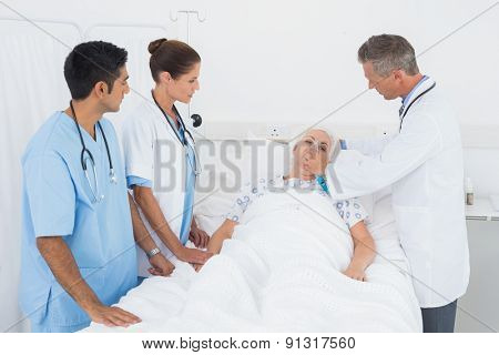 Doctor putting an oxygen mask in the hospital