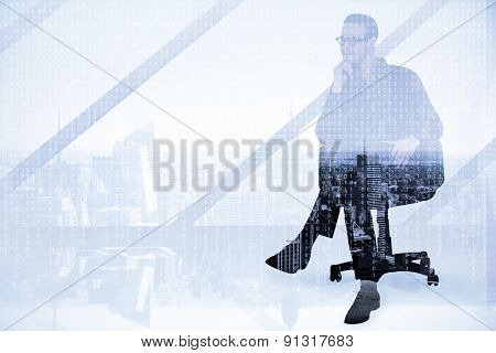 Thoughtful businessman sitting on a swivel chair against high angle view of city skyline