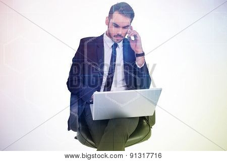 Businessman using laptop while phoning against digitally generated server room with towers