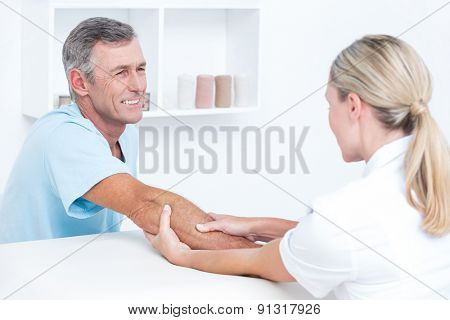 Doctor doing arm massage in medical office