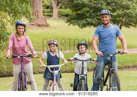 Happy family on their bike at the park on a sunny day